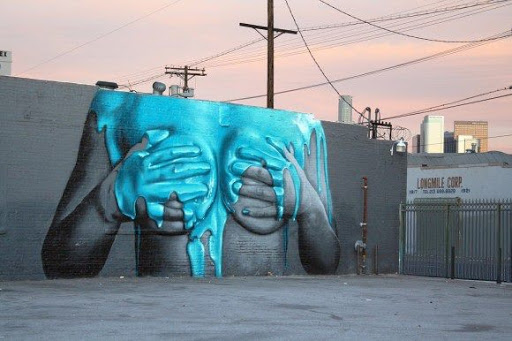 beautiful sexual street art with sun setting
